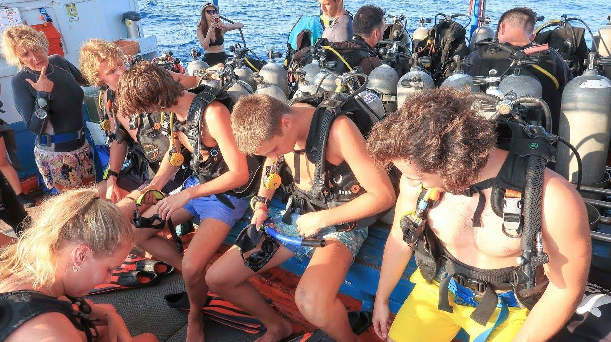 Checking dive equipment before the first dive on the Open Water course